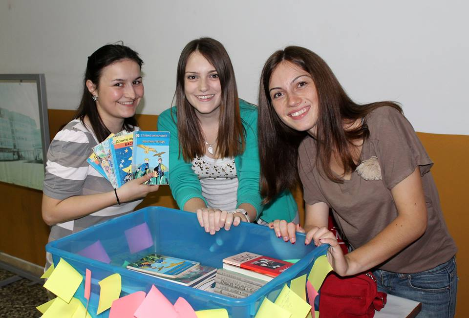 Volunteers from the Helsinki Citizen's Assembly gather books donated at a charity drive