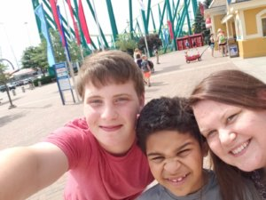 Selfie of Xander, Tricia, and their buddy at the amusement park