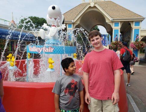 Xander and buddy at amusement park