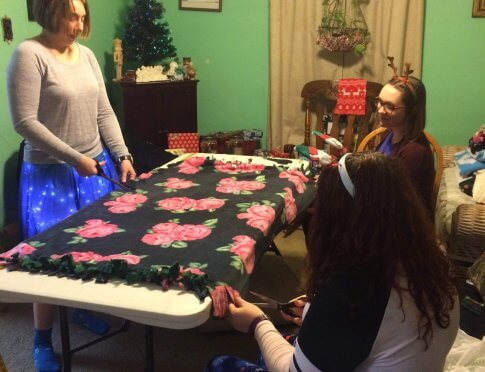 Part of the Crafting Team working away on fleece blankets.