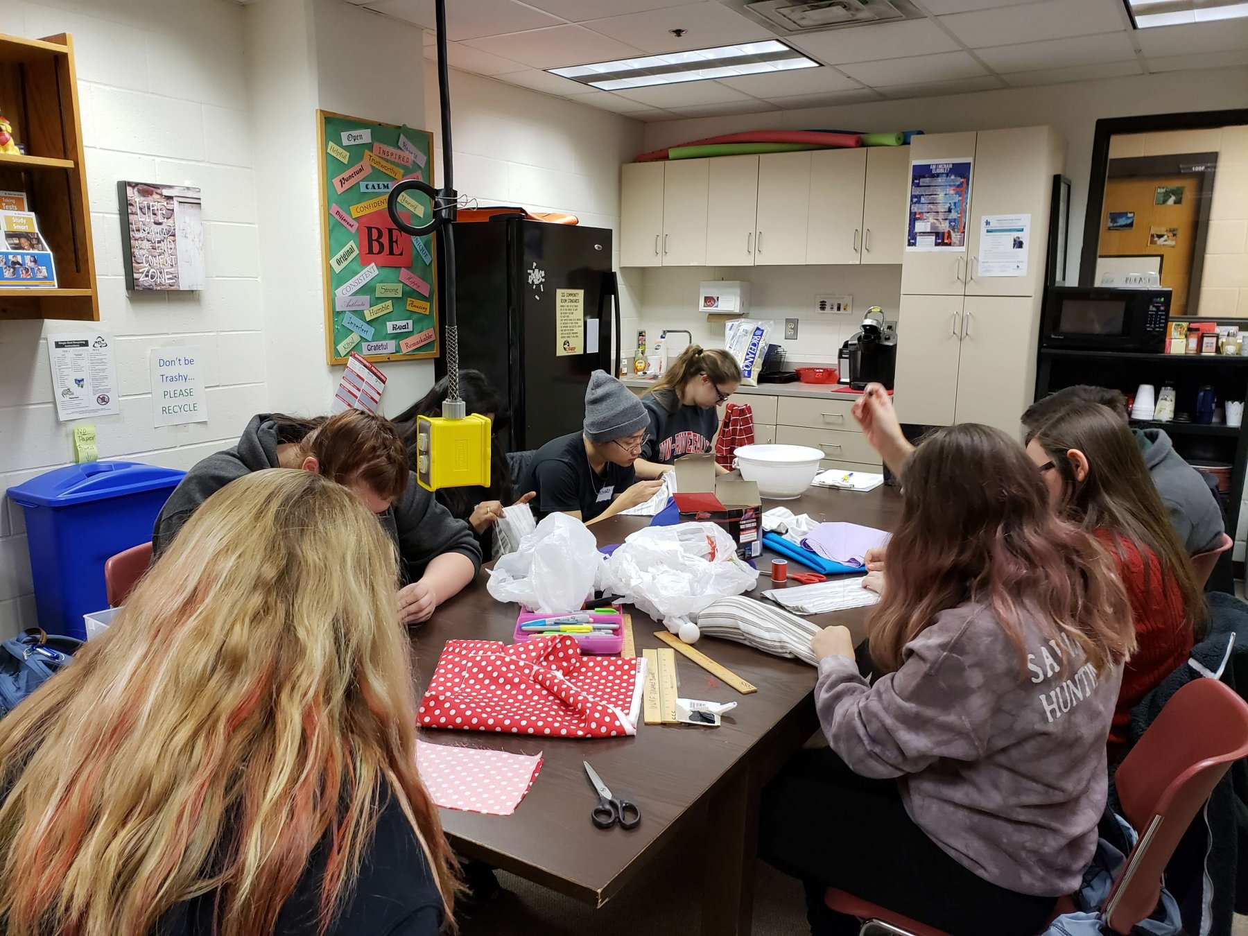 students crafting toys and cozies for shelter pets