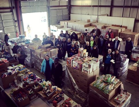 Food drive volunteers and collected donations.