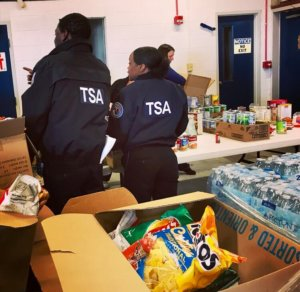 Federal employees picking up donated food.