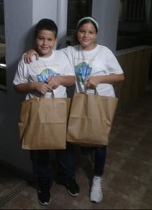 Children with food packs in Puerto Rico