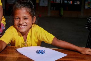 Smiling child at Dashain Camp