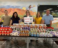 Roadrunner Food Bank staff with donations