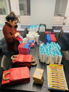 Suzie's team assembling hygiene bags for women experiencing homelessness