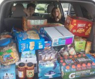 A car trunk full of food and supplies