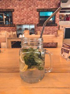 Clear glass mug with metal straw