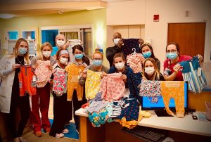 NICU nurses posing with donated clothes