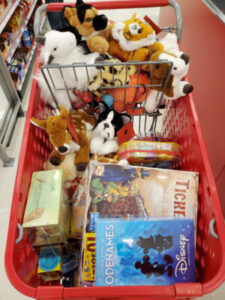 shopping cart full of various toys and games