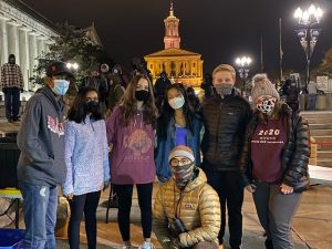 People wearing masks standing together