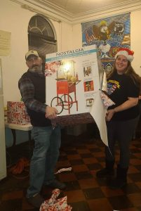 Nadine and John, a veteran, modeling with the donated popcorn machine
