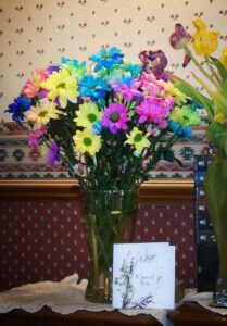 A rainbow bouquet for the loss of an emotional support animal.