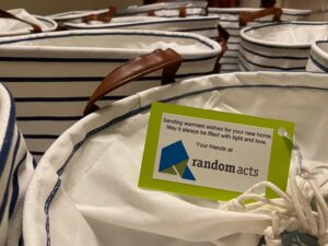 reusable striped laundry bags with welcome note from Random Acts