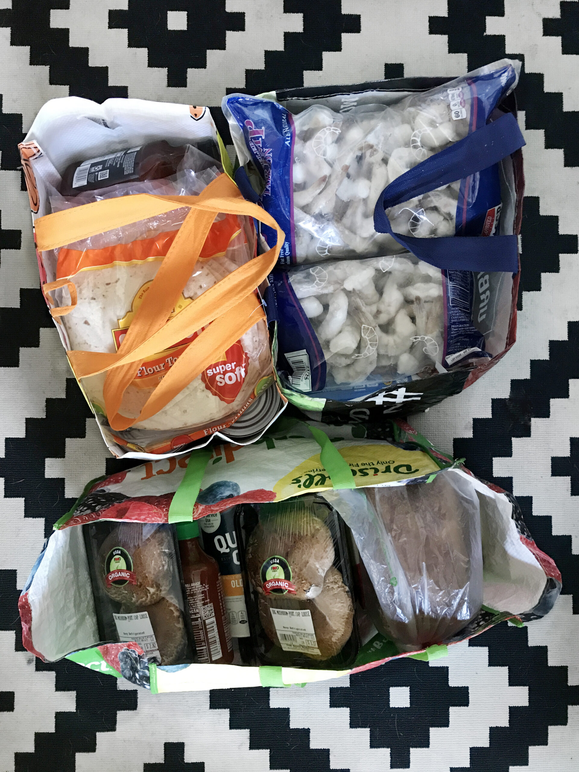 Three bags of groceries that Kathryn bought for her neighbor Jane