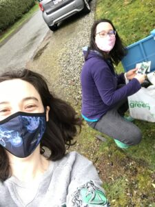 Rowan Meredith, alongside her friend, putting the vegetable seeds into the tiny metal box.