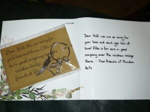 A keychain and condolence card for the loss of an emotional support animal.