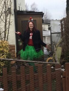 A woman wearing a holiday season-themed outfit